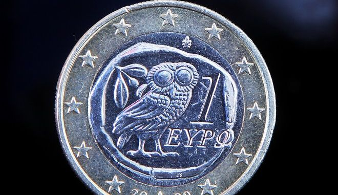 A Greek Euro coin is pictured in Frankfurt, Germany, Thursday, March 1, 2012. A panel convened by a securities dealers' association has ruled that an agreed restructuring of Greece's government debt is not yet a credit event. A finding of a credit event would trigger payouts to bond holders who hold credit-default swaps. Those are derivatives that act as insurance against default. The ruling by the committee convened by the International Securities Dealers' Association said the Greek bond deal is still being carried out and that the question could come up again. Greece and its bondholders agreed on a debt swap that will give investors new debt worth only 53.5 percent of the face value of their former holdings. (AP Photo/Michael Probst)