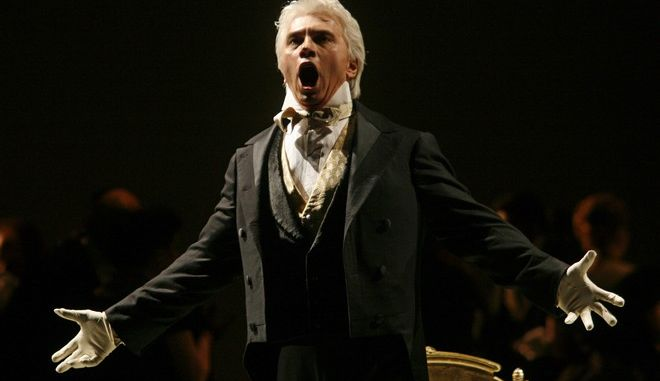 """FILE - In this Feb. 6, 2007 file photo, Dmitri Hvorostovsky performs during the final dress rehearsal for the opera """"Eugene Onegin"""" in New York. Hvorostovsky has withdrawn from four February 2016 performances of Verdi's """"Il Trovatore"""" at the Metropolitan Opera because of ongoing treatment for a brain tumor. The 53-year-old Russian baritone announced his diagnosis in June and canceled performances through August to undergo treatment in London. (AP Photo/Shiho Fukada, File)"""