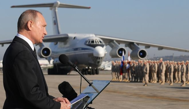 Russian President Vladimir Putin addresses to the troops at the Hemeimeem air base in Syria, on Monday, Dec. 11, 2017. Declaring a victory in Syria, Putin on Monday visited a Russian military air base in the country and announced a partial pullout of Russian forces from the Mideast nation. (Mikhail Klimentyev, Sputnik, Kremlin Pool Photo via AP)