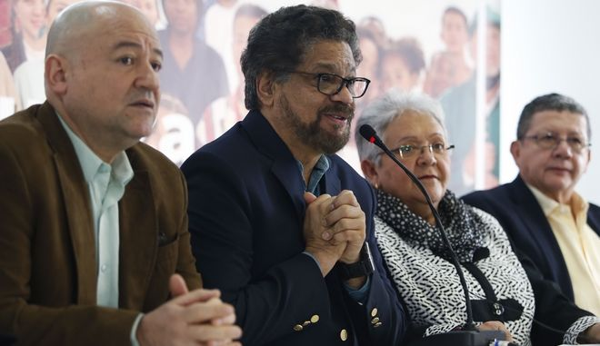 Ivan Marquez, a former leader of the Revolutionary Armed Forces of Colombia, FARC, announces the withdrawal of former guerrilla commander Rodrigo Londono from the race for president, citing both criticism of the political process and his serious health problems, at a press conference in Bogota, Colombia, Thursday, March 8, 2018. Also pictured are Carlos Lozada, from left, Imelda Daza and Pablo Catatumbo, Common Alternative Revolutionary Force political party leaders. (AP Photo/Fernando Vergara)