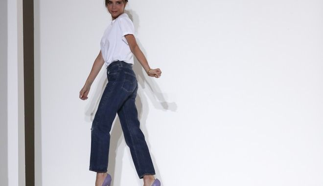 Victoria Beckham acknowledges the audience at the end of her Spring/Summer 2018 fashion show during New York Fashion Week, Sunday, Sept. 10, 2017. (AP Photo/Mary Altaffer)