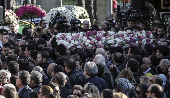 People carry flower-covered coffin of Mina Basaran during funeral prayers in Istanbul, Thursday, March 15, 2018. Funerals have been held for nine out of the 11 victims from a private Turkish jet that crashed in Iran while flying a bride-to-be and her friends back to Istanbul from a bachelorette party in the United Arab Emirates. Mina Basaran, the 28-year-old daughter of the chairman of Turkey's Basaran Investment Holding, was killed along with her seven friends, and three female crew members.(AP Photo/Emrah Gurel)