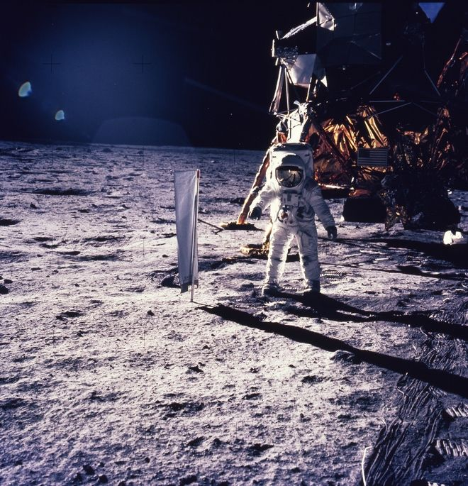 Astronaut Edwin E. Aldrin Jr. walks on the surface of the moon, July 30, 1969, with seismogaphic equipment which he just set up. The flag like object on a pole is a solar wind experiment and in the background is the Lunar Landing Module. (AP Photo/NASA/Neil Armstrong) (AP Photo/NASA/Neil Armstrong)