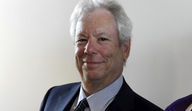 FILE - In this June 22, 2014 file photo US economist Richard Thaler poses for a photo during the award ceremony for the world economy prize in Kiel, Germany. The Nobel economics prize has been awarded to Thaler of the University of Chicago for his contributions to behavioral economics. (Carsten Rehder/dpa via AP, file)
