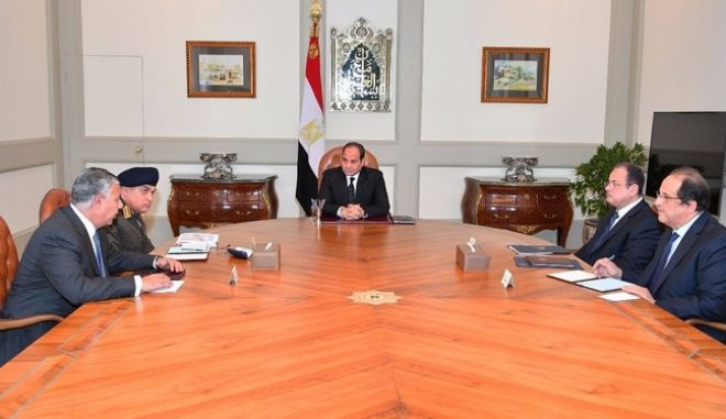 This photo released by Egypt's Presidency shows Abdel-Fattah El-Sissi, center, meeting with officials in Cairo after militants attacked a crowded mosque during Friday prayers in the Sinai Peninsula. The attackers set off explosives, spraying worshippers with gunfire and killing at least 184 people in the deadliest ever attack on Egyptian civilians by Islamic extremists. (Egyptian Presidency via AP)