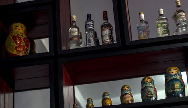 In this Aug 20, 2014, photo, Matryoshka dolls and bottles of vodka sit on display at the Nazdarovie restaurant during its pre-launch in Havana, Cuba. Occupying the third story of a historic building on the seafront Malecon boulevard, Nazdarovie is an homage to the old country. (AP Photo/Ramon Espinosa)