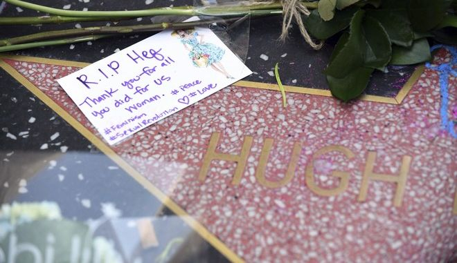 Flowers and a card appear on Hugh Hefner's star on the Hollywood Walk of Fame, Thursday, Sept. 28, 2017 in Los Angeles. Hefner died of natural causes at his home on Wednesday at the age of 91. (AP Photo/Axel Koester)