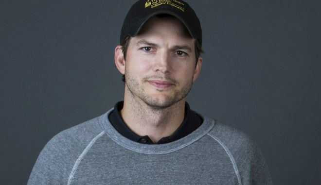 """In this Oct. 6, 2016 photo, Ashton Kutcher poses for a portrait to promote the second season of his Netflix series, """"The Ranch,"""" in New York. (Photo by Amy Sussman/Invision/AP)"""