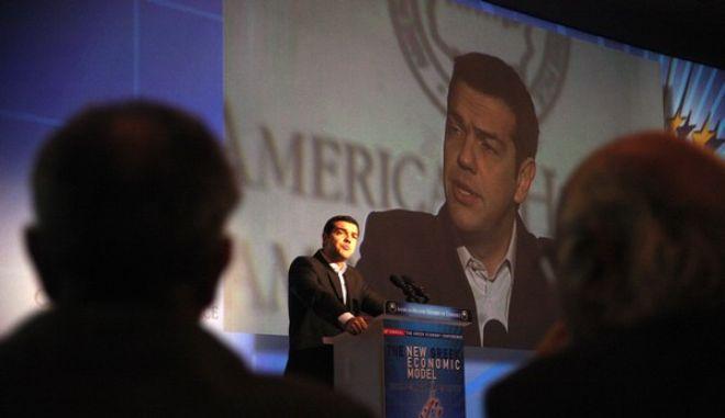 Ο Πρόεδρος του ΣΥΡΙΖΑ, Αλέξης Τσίπρας, στην κεντρική ομιλία στο 24ο ετήσιο συνέδριο του Ελληνοαμερικανικού Εμπορικού Επιμελητηρίου «Η ΩΡΑ ΤΗΣ ΕΛΛΗΝΙΚΗΣ ΟΙΚΟΝΟΜΙΑΣ», την Τρίτη 3 Δεκεμβρίου 2013, στο ξενοδοχείο Athenaeum Intercontinental. (EUROKINISSI/ΑΛΕΞΑΝΔΡΟΣ ΖΩΝΤΑΝΟΣ)