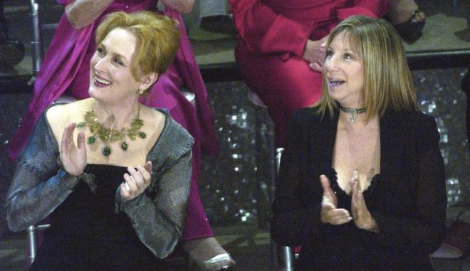 """FILE - In this March 23, 2003, file photo, actresses Meryl Streep, left, and Barbra Streisand applaud on stage during a reunion of past Oscar winners during the 75th Academy Awards in Los Angeles. Streisand told MSNBC """"Hardball host Chris Matthews Monday that she completely agrees with Streep's criticisms of Trump during the Golden Globes on Sunday, Jan. 8, 2017. (AP Photo/Kevork Djansezian, File)"""