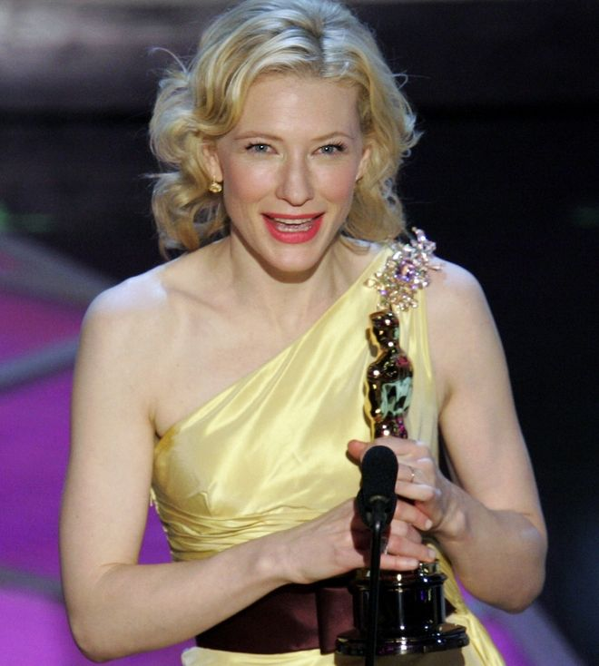 """**EMBARGOED AT THE REQUEST OF THE MOTION PICTURE ACADEMY FOR USE UPON CONCLUSION OF THE ACADEMY AWARDS TELECAST** Actress Cate Blanchett accepts the Oscar for best supporting actress for her work in """"The Aviator"""" at the 77th Academy Awards Sunday, Feb. 27, 2005, in Los Angeles. (AP Photo/Mark J. Terrill)"""