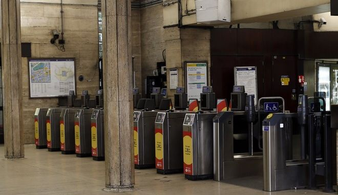 A hallway with ticket machines stands empty at St.James's Park Tube station in London, Thursday, Aug. 6, 2015. Commuters are facing a day of disruption after a strike shut down the London Underground system for a second time this summer. Unions walked off the job amid a dispute about how to implement a new 24-hour service on weekends. Unions argue work-life balance issues haven't been addressed and that management should hire more people to cover extra shifts. (AP Photo/Frank Augstein)