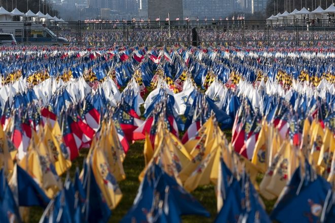 Flags are placed on the National Mall ahead of the inauguration of President-elect Joe Biden and Vice President-elect Kamala Harris, Monday, Jan. 18, 2021, in Washington. (AP Photo/Alex Brandon)