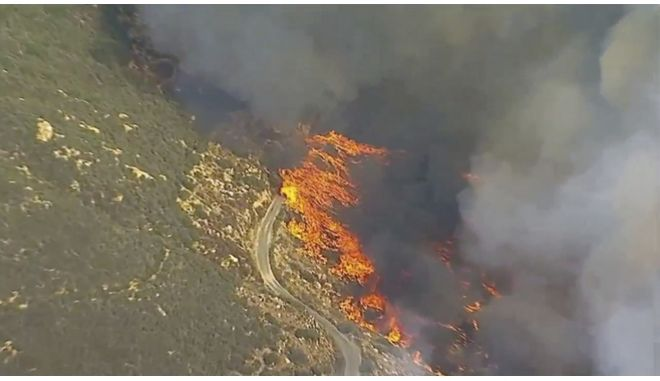 In this Friday, Oct. 27, 2017, still image taken from a video provided by KABC-TV, a wildfire burns in Cleveland National Forest in Wildomar, Calif. The fire began early Thursday afternoon in the Wildomar Off-Highway Vehicle Area in the Cleveland National Forest, about 70 miles (112 kilometers) southeast of Los Angeles. (KABC-TV via AP)
