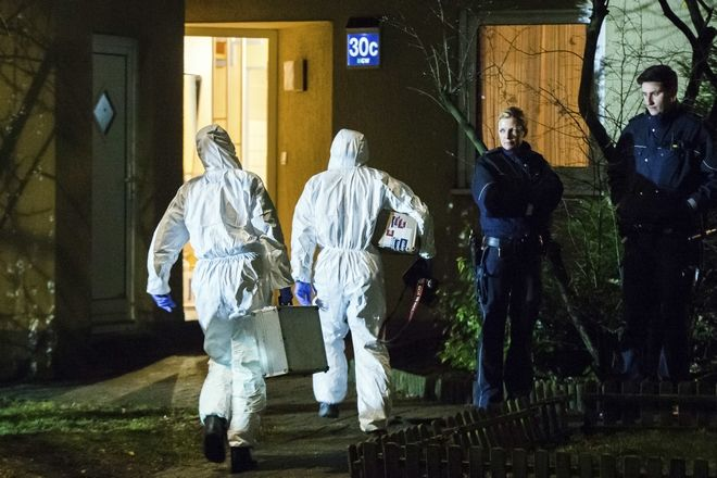 Forensic scientists enter a house in Herne, Germany, Tuesday, March 7, 2017. German police said Tuesday they have launched a manhunt for a 19-year-old man who allegedly killed a 9-year-old boy in the western town of Herne and boasted about the murder on a video posted online. (Marcel Kusch/dpa via AP)
