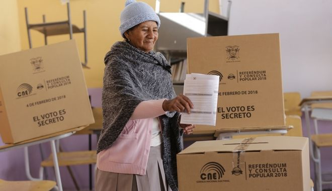 A woman casts her vote during a constitutional referendum called by President Lenin Moreno in Quito, Ecuador, Sunday, Feb. 4, 2018. Moreno called for the nationwide referendum that will include a question asking voters whether they want to revoke a law pushed forward by his predecessor allowing presidents to be indefinitely re-elected. (AP Photo/Dolores Ochoa)
