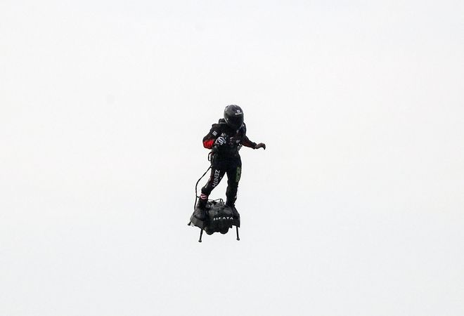 French inventor Franky Zapata prepares to land near St. Margaret's beach, Dover Sunday, Aug. 4, 2019. Zapata has successfully flown over the English Channel on a personal flying machine. (Steve Parsons/PA via AP)