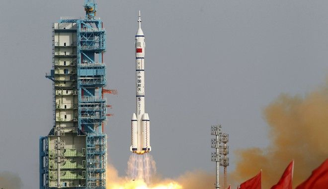 FILE - In this file photo taken Saturday, June 16, 2012, a Shenzhou 9 spacecraft Long March rocket with 3 astronauts including China's first female astronaut launches from the Jiuquan Satellite Launch Center in Jiuquan, China. The country introduced its Long March series of rockets in 1970. The program's success rate of about 95 percent makes it a cornerstone of China's space endeavors. It has had a few setbacks, notably a Long March 5 rocket that plunged into the Pacific minutes after takeoff in July 2017. (AP Photo/Ng Han Guan, File)