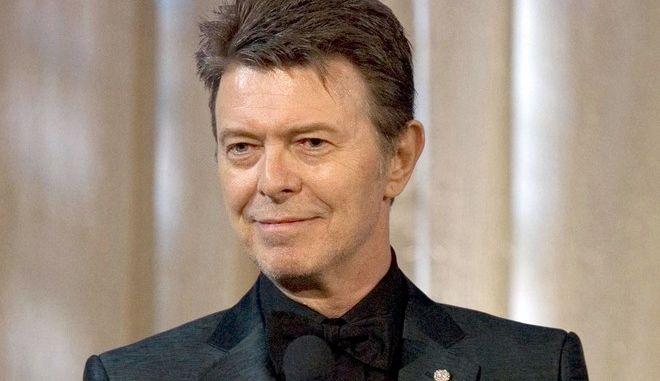 CORRECTS TO STATE THAT ALBUM WAS RELEASED BEFORE HIS DEATH - FILE - In this June 5, 2007 file photo, singer David Bowie accepts the lifetime achievement award at the 11th Annual Webby Awards in New York.  Bowie's final album, released days before he died of cancer last year, earned him three Grammy Awards on Sunday, Feb. 12, 2017.  (AP Photo/Stephen Chernin, File)