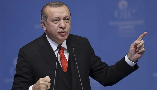 "Turkey's President Recep Tayyip Erdogan gestures as he delivers his speech in the opening session of the Organisation of Islamic Cooperation Extraordinary Summit in Istanbul, Wednesday, Dec. 13, 2017. Leaders and high-ranking officials of Muslim countries met in Istanbul to discuss the U.S. recognition of Jerusalem as Israel's capital. Erdogan_ term president of OIC, the umbrella organisation of 57-members, has been vehemently critical of the U.S. move and said the leaders would relay a ""strong message."" (Emrah Yorulmaz/Pool Photo via AP)"