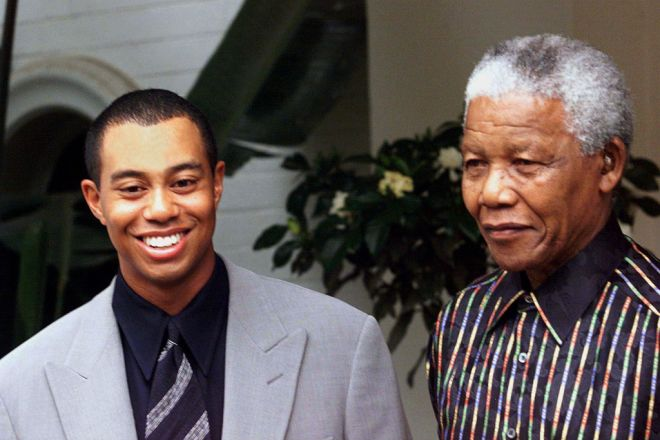 Golf superstar Tiger Woods smiles as he meets South African President Nelson Mandela at the presidential residence in Houghton, Johannesburg November 30. Woods came to South Africa to play in the One Million-Dollar golf tournament played in Sun City starting December 3. **DIGITAL IMAGE** - RTXHV40