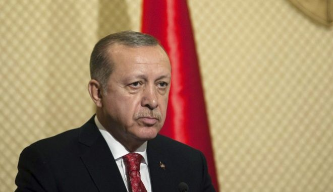 """Turkish President Recep Tayyip Erdogan pauses as he speaks during a media conference at the Presidential Palace in Carthage, outside Tunis, Tunisia, Wednesday, Dec. 27, 2017. Syria's peace efforts cannot include President Bashar Assad, Turkey's leader said Wednesday, calling him a """"terrorist."""" (AP Photo/Hassene Dridi)"""