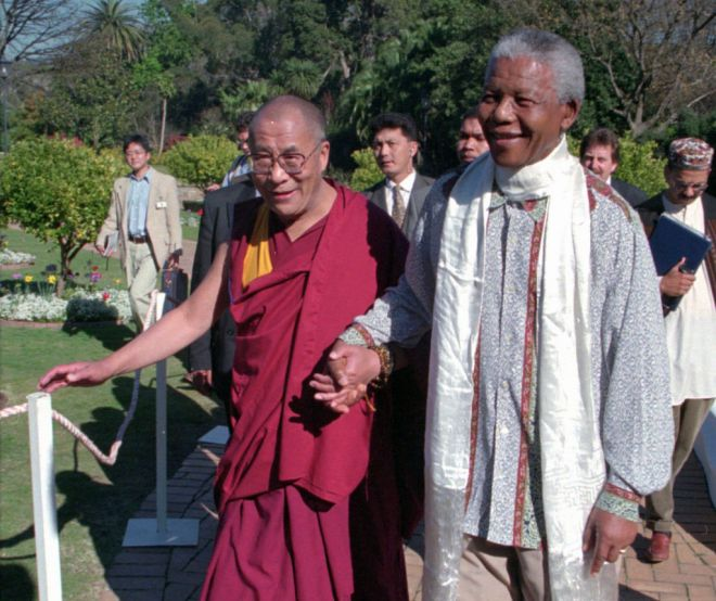 ** FILE ** In this Wednesday August 21, 1996, file photo Tibetan leader the Dalai Lama, left, meets with President Nelson Mandela, right, in Cape Town South Africa. South Africa said Monday, March 23, 2009,  it wanted to avoid being the source of bad publicity about trading partner China, and ended up itself the target of sharp criticism for barring the Dalai Lama from a peace conference in Johannesburg later this week. Friday's conference is now the target of a boycott by retired Cape Town Archbishop Desmond Tutu, former president F.W. de Klerk and members of the Nobel Committee who had been expected to be among Nobel laureates, Hollywood celebrities and other dignitaries discussing issues ranging from combatting racism to promoting sports to bring people and nations together. (AP Photo/Sasa Kralj, File)