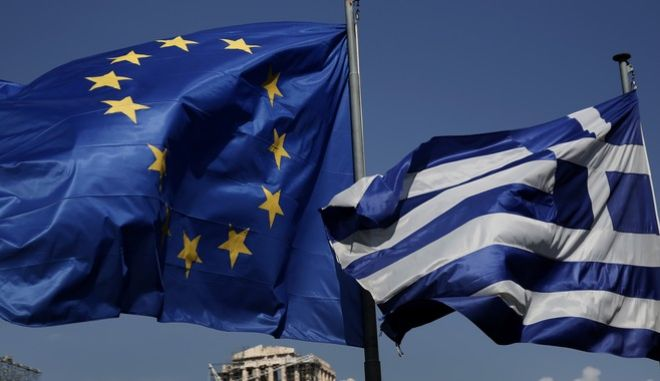 An EU and a Greek flag fly in front of the ancient Parthenon temple, in Athens, on Wednesday, April 9, 2014. Greece announced Wednesday it was returning to international bond markets for the first time in four years amid growing signs of confidence in the country at the forefront of the European debt crisis. (AP Photo/Petros Giannakouris)