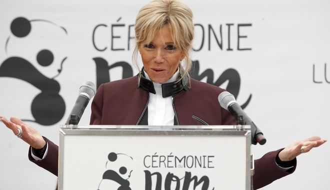 French First lady Brigitte Macron delivers her speech during a naming ceremony of the panda born at the Beauval Zoo, in Saint-Aignan-sur-Cher, France, Monday, Dec. 4, 2017. The 4-month-old cub is called Yuan Meng, which means