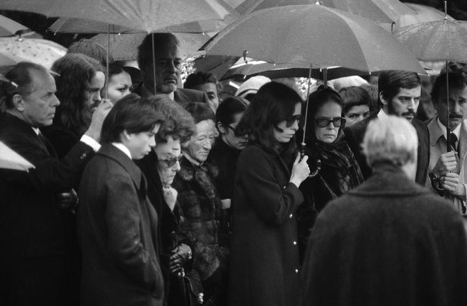 The widow of late British-born comedian and movie actor Charlie Chaplin, Oona Chaplin, right, with one of her daughters, left, during funeral service at Corsier cemetery, Switzerland on Dec. 27, 1977. Chaplin died at his Corsier residence on December 25. He was 88 years old. (AP Photo/Kurt Strumpf)