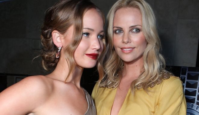 """BEVERLY HILLS, CA - SEPTEMBER 14: Jennifer Lawrence and Charlize Theron at Charlize Theron's """"The Burning Plain"""" After Party Premiere partnered by Grey Goose and C Magazine on September 14, 2009 at the Thompson Hotel in Beverly Hills, California. (Photo by Eric Charbonneau/Invision/AP Images)"""