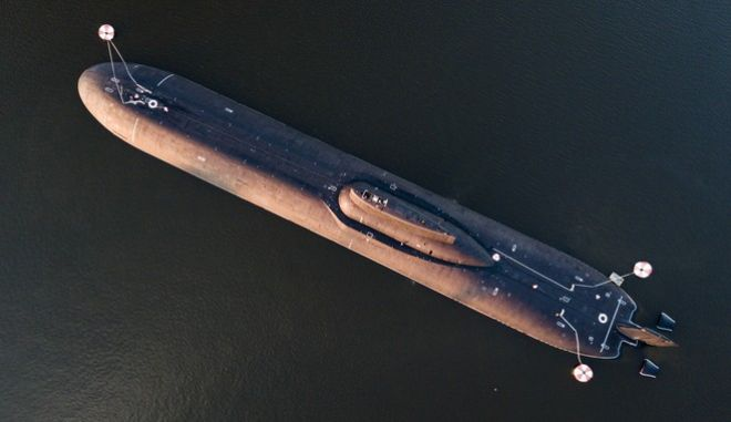 In this aerial photo, the Russian nuclear submarine Dmitry Donskoy moored near Kronstadt, a seaport town 30 km (19 miles) west of St. Petersburg, Russia, July 28, 2017. (AP Photo/Elena Ignatyeva)
