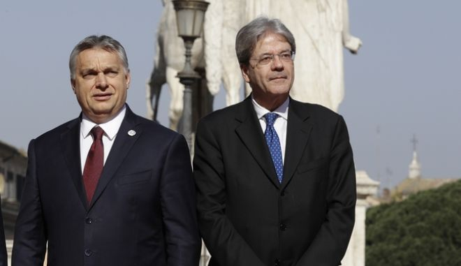 From left, Malta's Prime Minister Joseph Muscat, European Council President Donald Tusk, Hungarian Prime Minister Viktor Orban and Italian Prime Minister Paolo Gentiloni during arrivals for an EU summit at the Palazzo dei Conservatori in Rome on Saturday, March 25, 2017. EU leaders gather in Rome on Saturday to celebrate the 60th anniversary of the EU's founding treaty. (AP Photo/Andrew Medichini)
