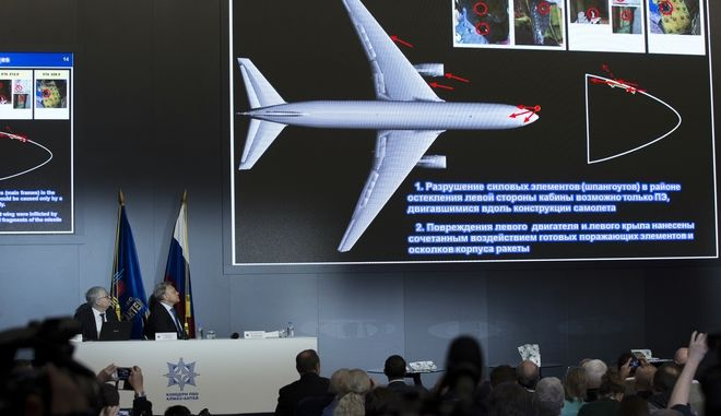Almaz-Antei director Yan Novikov, seated center, attends a news conference in Moscow, Russia, Tuesday, Oct. 13, 2015. Almaz-Antei air defense consortium, the builder of Buk missiles, presents its vision of the MH-17 air crash based on a new modeling of the disaster they recently conducted. (AP Photo/Pavel Golovkin)