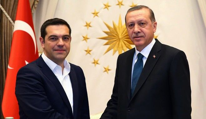 "Greece's Prime Minister Alexis Tsipras, left, and Turkish President Recep Tayyip Erdogan shake hands before a meeting in Ankara, Turkey, Wednesday, Nov. 18, 2015. Turkey and Greece have agreed to cooperate to prevent the ""human tragedy"" suffered by thousands of migrants who risk lives crossing the Aegean Sea on their way to Europe. Davutoglu and Tsipras said however, that the refugee burden cannot be placed on the two countries' shoulders alone, insisting that other European nations share the responsibility.(Presidential Press Service/Pool Photo via AP)"