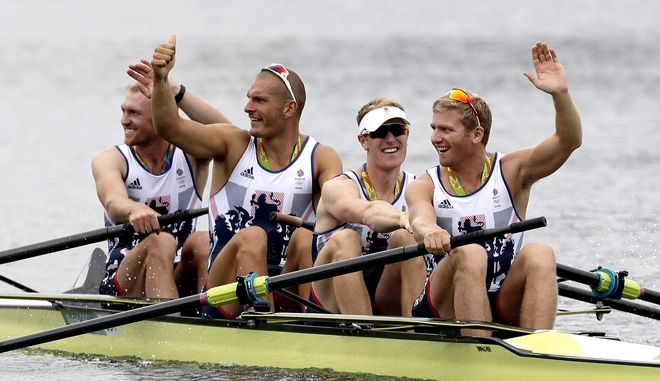 Alex Gregory, Mohamed Sbihi, George Nash and Constantine Louloudis, of Britain, wave after winning gold in the men's rowing four final during the 2016 Summer Olympics in Rio de Janeiro, Brazil, Friday, Aug. 12, 2016. (AP Photo/Luca Bruno)