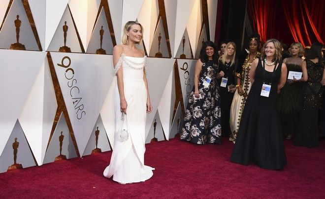 Margot Robbie arrives at the Oscars on Sunday, March 4, 2018, at the Dolby Theatre in Los Angeles. (Photo by Jordan Strauss/Invision/AP)