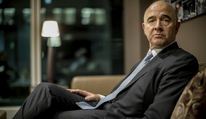 European Commissioner for Economic and Financial Affairs, Taxation and Customs, Pierre Moscovici, poses for photographs in Berlin, Germany, Thursday Nov. 9, 2017.  (Michael Kappeler/dpa via AP)