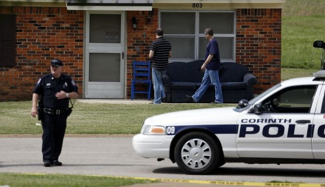 United States Capitol Police begin a neighborhood canvas, in the background, while Corinth police officers prevent access to a house in the West Hills Subdivision in Corinth, Miss., on Thursday morning, April 18, 2013. Law enforcement officials blocked off the dwelling after taking Paul Kevin Curtis of Corinth, Miss., into custody under the suspicion of sending letters covered in ricin to the U.S. President Barack Obama and U.S. Sen. Roger Wicker, R-Miss. Curtis was arrested at his home in Corinth, Miss. (AP Photo/Rogelio V. Solis)