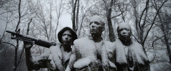 WASHINGTON, DC - MARCH 05:  Heavy snow coats The Three Soldiers statue near the Vietnam Veterans Memorial on the National Mall March 5, 2015 in Washington, DC. As a huge winter storm moves across the United States from Texas to Maine, the capital region is forecast to get five to ten inches of snowfall.  (Photo by Chip Somodevilla/Getty Images)