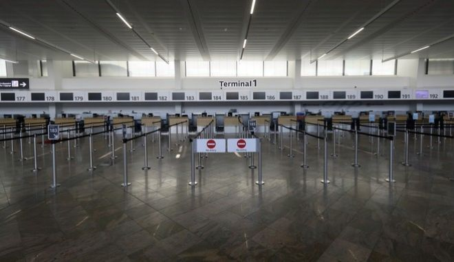 A view of closed check in counters at Vienna's Schwechat airport, Austria, Monday, March 23, 2020. For most people the coronavirus causes mild or moderate symptoms, such as fever and cough, but for some, especially older adults and people with existing health problems, it can cause more severe illness, including pneumonia. (AP Photo/Ronald Zak)