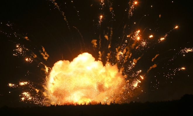 A powerful explosion is seen in the ammunition depot at a military base in Kalynivka, west of Kiev, Ukraine, early Wednesday, Sept. 27, 2017. More than 30,000 residents have been evacuated after ammunition depot exploded late Tuesday. (AP Photo/Efrem Lukatsky)