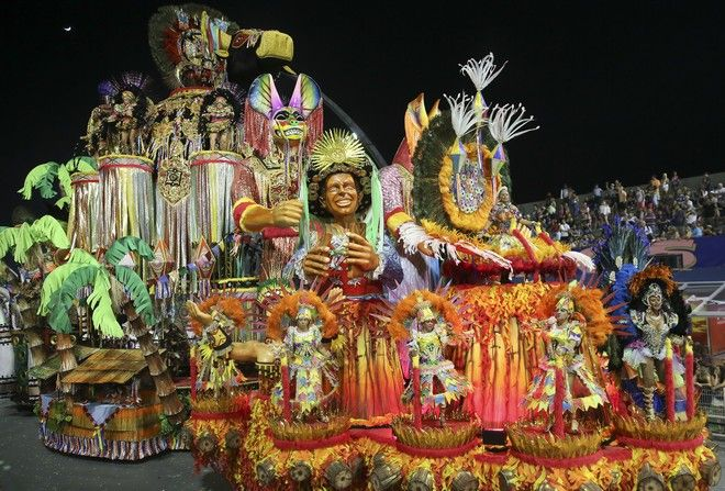 Dancers from the Academicos do Tatuape samba school perform on a float during a carnival parade in Sao Paulo, Brazil, Saturday, Feb. 10, 2018. (AP Photo/Andre Penner)