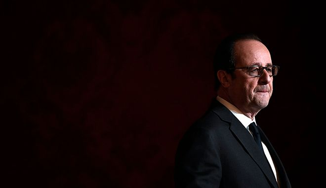 French President Francois Hollande delivers a speech after awarding the Legion of Honour (Legion d'Honneur) and the National Order of Merit (Ordre National du Merite) to Olympic and Paralympic athletes at the Elysee Presidential Palace in Paris, France, Thursday, Dec. 1, 2016. French President Hollande says he's not running in 2017 because he knows he might not have enough support. (Lionel Bonaventure/Pool Photo via AP)
