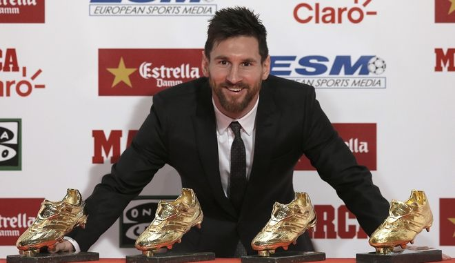 FILE - In this file photo dated Friday, Nov 24, 2017, FC Barcelona's Lionel Messi poses after receiving his fourth Golden Shoe award for leading all of Europe's leagues in scoring last season in Barcelona, Spain.  Messi has signed a new contract Saturday Nov. 25, 2017, that will keep the star at the Spanish club for four more years. (AP Photo/Manu Fernandez, FILE)