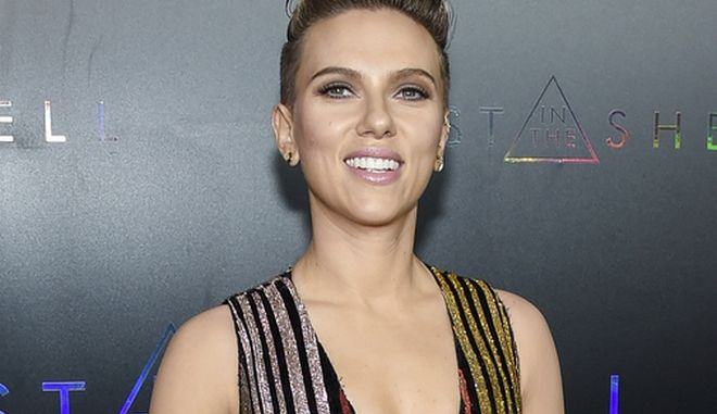 "FILE - In this March 29, 2017 file photo, actress Scarlett Johansson attends the premiere of ""Ghost in the Shell"" in New York. Johansson will serve as a presenter at this year's Tony Awards on June 11. (Photo by Evan Agostini/Invision/AP, File)"