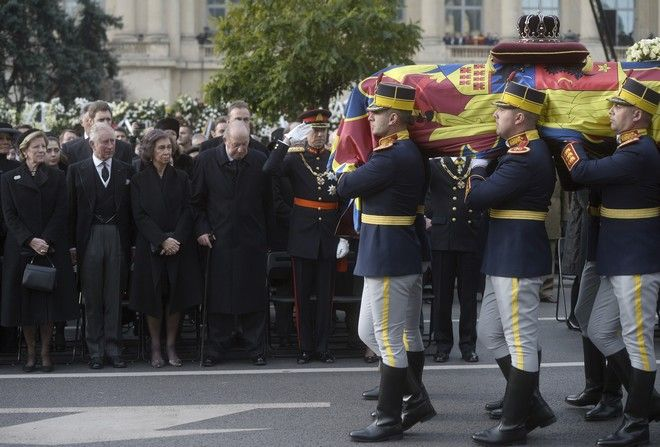 Honor guard soldiers carry the coffin of the late Romanian King Michael during the funeral ceremony in Bucharest, Romania, Saturday, Dec. 16, 2017. Tens of thousands of Romanians joined the European royals on Saturday to pay their respects to late King Michael as a state funeral got underway. Michael, who ruled Romania twice before being forced to abdicate by the communists in 1947, died at the age of 96 in Switzerland this month. (AP Photo/Andreea Alexandru)