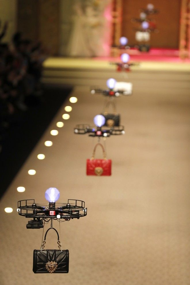 Drones carry handbags as part of the Dolce & Gabbana women's Fall/Winter 2018-2019 collection, presented during the Milan Fashion Week, in Milan, Italy, Sunday, Feb. 25, 2018. (AP Photo/Antonio Calanni)