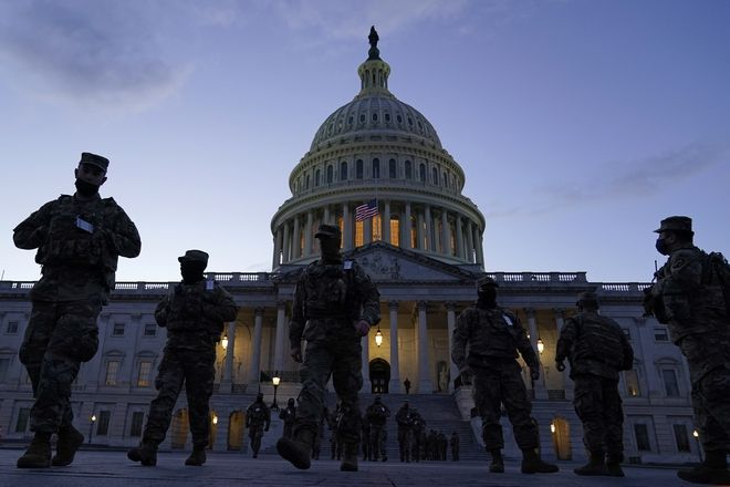 National Guard troops gather on the East front of the U.S. Capitol in Washington, Monday, Jan. 18, 2021, ahead of the 59th Presidential Inauguration. (AP Photo/Susan Walsh)