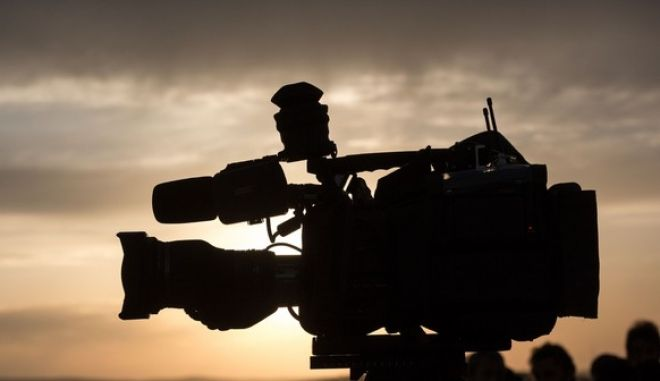 A camera filming the town of Kobane on a media hill in Mursitpinar on the outskirts of Suruc, near the Turkey-Syria border on November 9, 2014.